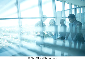 Shadows of workers - Shadows of businesspeople viewed...