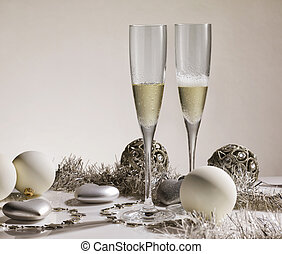 Pair of champagne glasses with silver ornaments and christmas balls