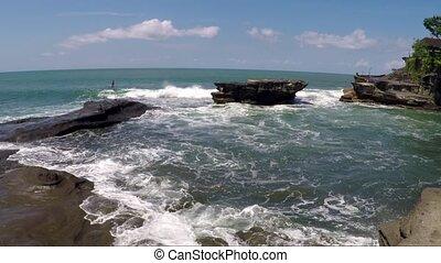View of waves beat against rocks on seashore - Waves beat...