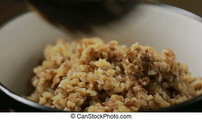 buckwheat porridge with butter. stirring spoon