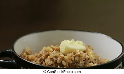 buckwheat porridge with butter. butter melts into slush
