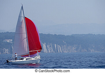 Sailboat and red spinnaker in Bandol, France - Small...