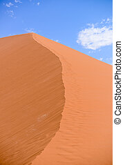 sand dune with blue sky