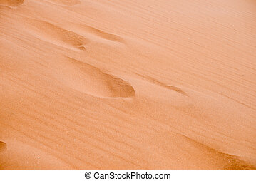 sand dune with footprints