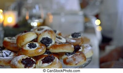 Freshly baked sweet buns filled with cottage cheese and jam.