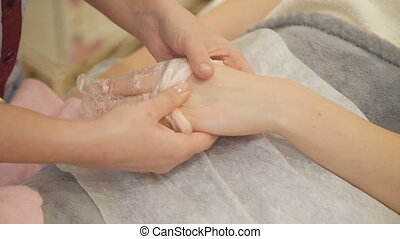 Taking off the gloves with paraffin from hands. Full HD