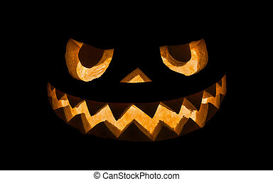 Halloween pumpkin in dark colors on a black background