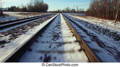 AERIAL. Camera flight from train tracks to the high winter...