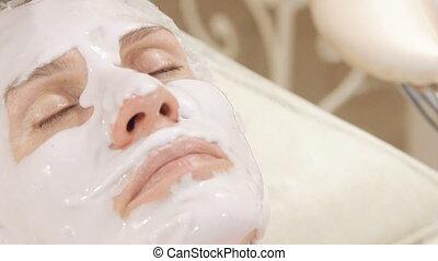 Applying of alginate facial mask. Full HD
