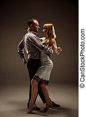 The man and the woman dancing argentinian tango - A man and...
