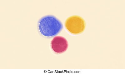 Yellow, Cyan and Magenta Mixture - Three daubs of yellow,...