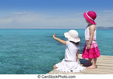 two girls tourist turquoise sea goodbye hand gesture - two...