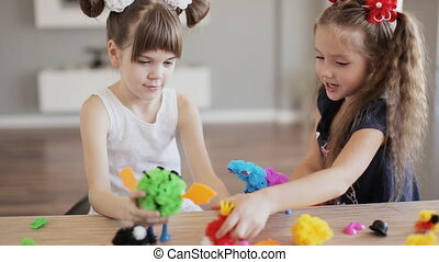 two pretty girls play with toys indoor