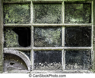 Window Frame Grunge - An old cracked window on an abandoned...
