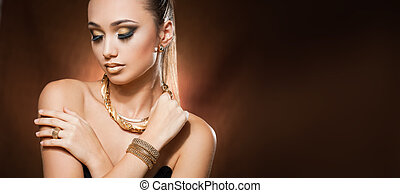 Gold luxury. - Portrait of a gorgeous young brunette woman...