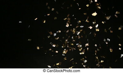 Golden confetti falling down on black background
