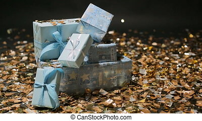 foto's blue box gifts and Golden confetti on a black...