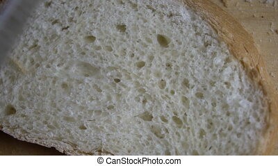 Male hand cutting slice of bread. - Male hand cutting fresh...