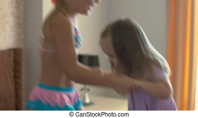 Happy children jumping on the bed and having fun - Happy...