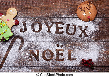 text joyeux noel, merry christmas in french - high-angle...