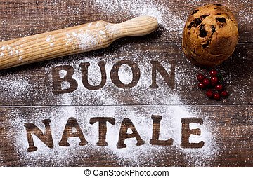 text buon natale, merry christmas in italian - high-angle...