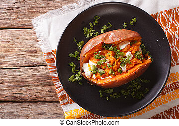 Whole sweet potato baked with cheese, spices and parsley...