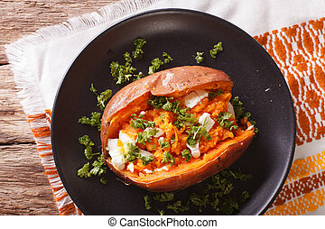 Orange sweet potatoes baked with cream cheese, spices and...