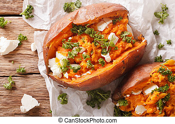 healthy food: baked sweet potato stuffed with cheese and...