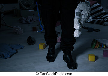 Thief with teddy bear - Dangerous thief holding crowbar and...