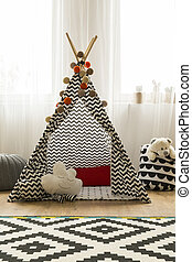 Patterned indian tent in monochromatic room - Patterned...