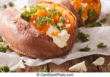 sweet potatoes baked with feta cheese and parsley macro on...