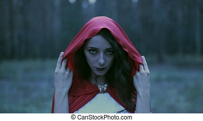 Halloween video with terrible woman in the woods. - bloody...