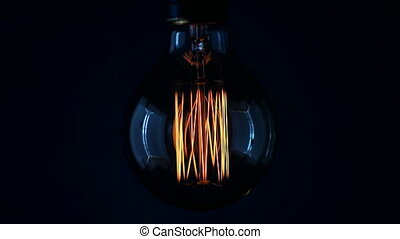 Real Edison light bulb flickering. Vintage filament Edison...