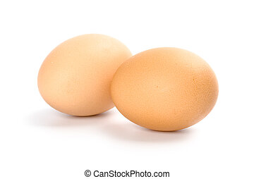 two brown eggs isolated on white background