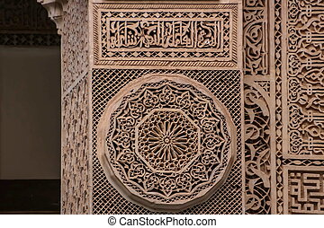 Islamic calligraphy and colorful geometric patterns a Morocco.