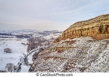 sandstone cliff and river aerial view