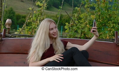 Young woman making selfie - Young woman with long blonde...