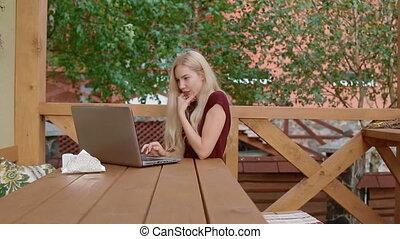 Young woman communicate using laptop - Young caucasian woman...