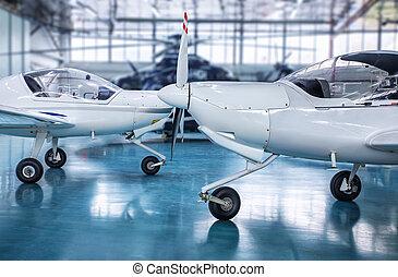 hangar - white planes in a hangar