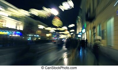 Warsaw Christmas decorated street in the evening. European...