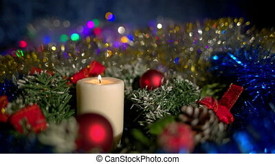 Christmas composition with candle and light