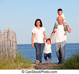 Family at beach - Good looking family going for a walk at...