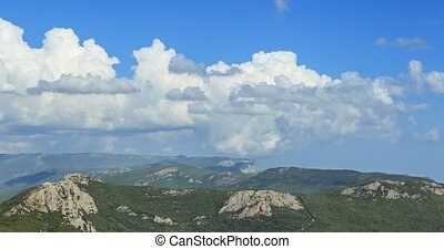 Clouds over the mountains, the south of the Crimea. Zoom....