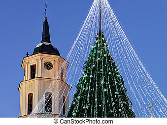 Christmas tree with decorations and Belfry of Cathedral Square