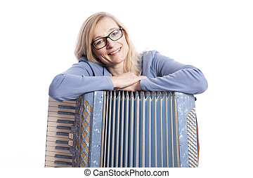 woman in blue with glasses leans on accordeon and smiles -...