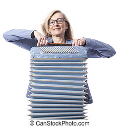 woman in blue with glasses holds accordeon and smiles -...