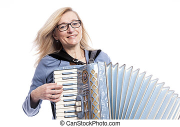 woman in blue with glasses plays accordeon and smiles -...