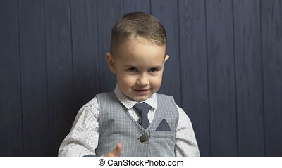 Elegant Kid Boy Shows Thumb Up - Happy smiling kid boy shows...