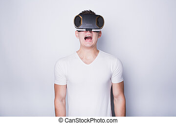 Young man trying vr goggles - Handsome guy trying vr...