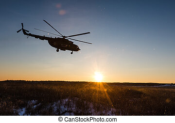 Ukrainian army helicopter patrols the area of of the...